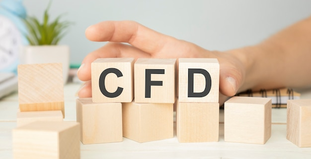 Cfd - acronimo da blocchi di legno con lettere, concetto di investimento cfd contratto per differenza