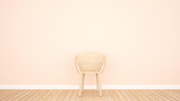 Sedia e spazio vuoto sulla parete rosa per opere d'arte