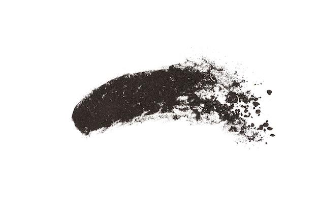 Spruzzi di polvere di carbone su sfondo bianco motion blur