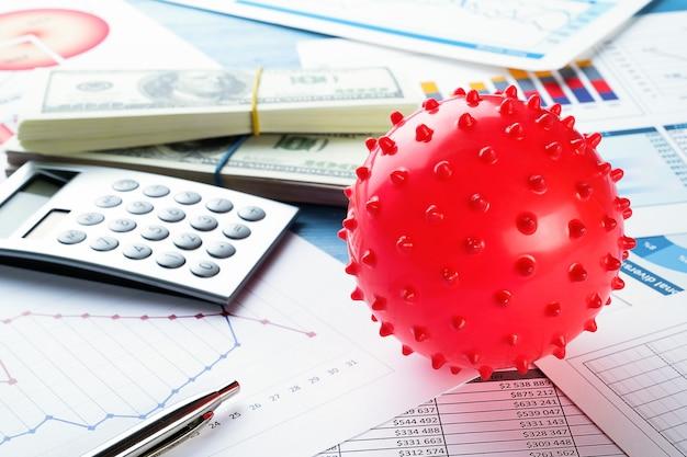 Grafici e istogrammi, denaro, calcolatrice. l'ascesa e la caduta dell'economia mondiale, indicatori finanziari e reddito.