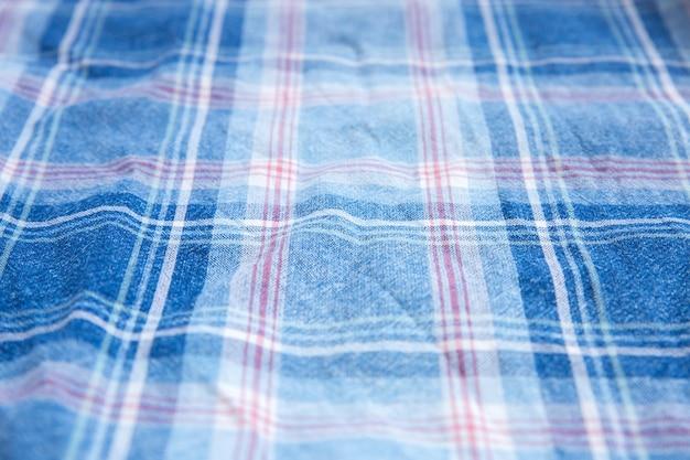 Trama di stoffa a scacchi. quadrati su tessuto. sfondo di tessuti naturali.