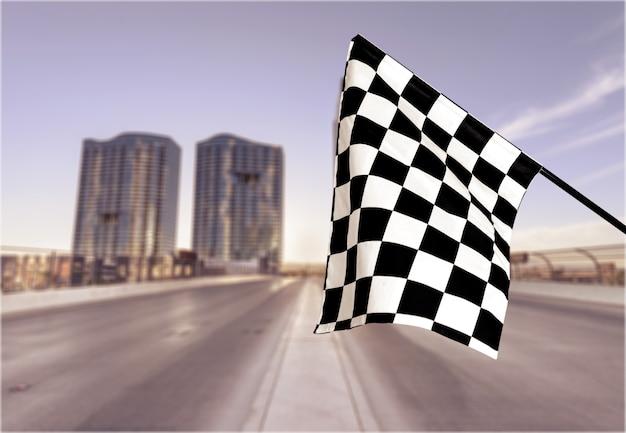 Bandiera a scacchi isolato su sfondo. foto concettuale del vincitore
