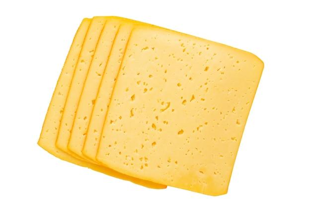 Fetta di formaggio sulla superficie bianca.