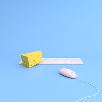 Formaggio con mouse e tastiera del computer.