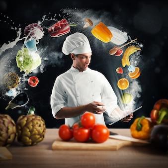 Lo chef legge una ricetta di cibo dal tablet