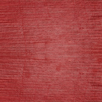 Sfondo rosso ciliegia con effetto texture cemento