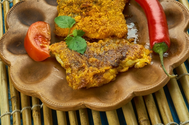 Chettinad fish fry - cucina chettinad, filetto di pesce marinato in masala stile chettinad e poi fritto in olio