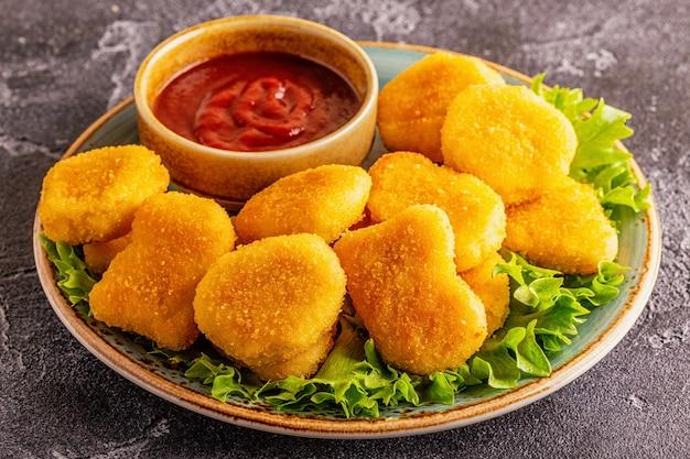 Bocconcini di pollo con salsa di pomodoro