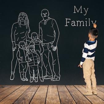Il bambino disegna una famiglia sul muro