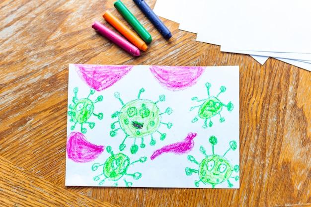 Coronavirus di disegno per bambini molti virus attaccano i pastelli del corpo umano, matite colorate, creatività dei bambini, creazione di artigianato, decorazione della casa, tempo con i bambini, sviluppo delle abilità, scuola, casa