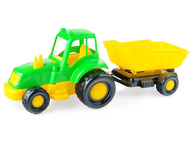 Camion di plastica per bambini su uno sfondo bianco, close-up.