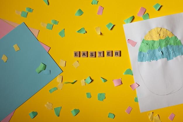 Progetto artistico per bambini artigianato artigianato per bambini uovo di pasqua di carta carta colorata dappertutto iscrizione pasqua