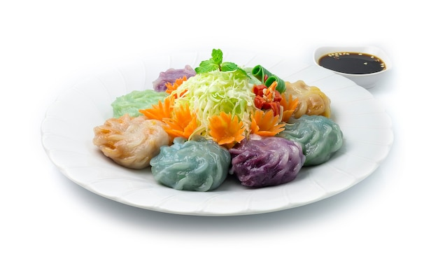 Gnocchi cinesi di erba cipollina colore misto o torta di riso dim sum all'aglio