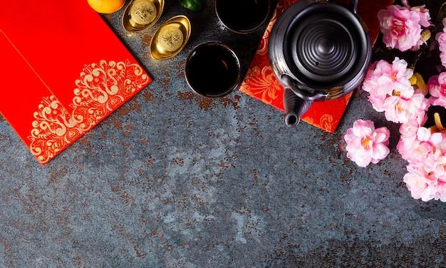 Decorazioni per il capodanno cinese, pacchetto pow o rosso, lingotti arancioni e oro