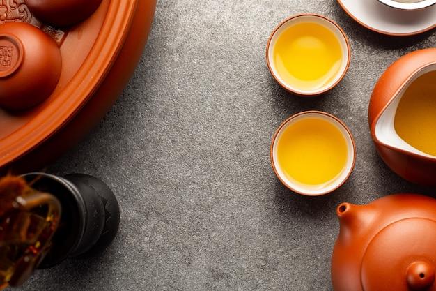 Fondo tradizionale della bevanda di erbe del tè cinese. set di tazze da tè cinesi.