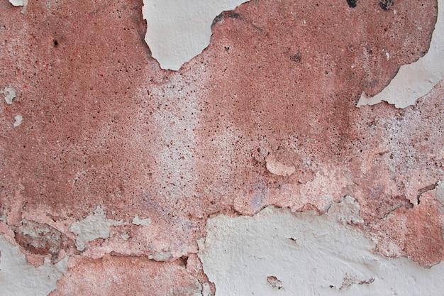 Struttura della parete scheggiata nei toni del rosso. sfondo.