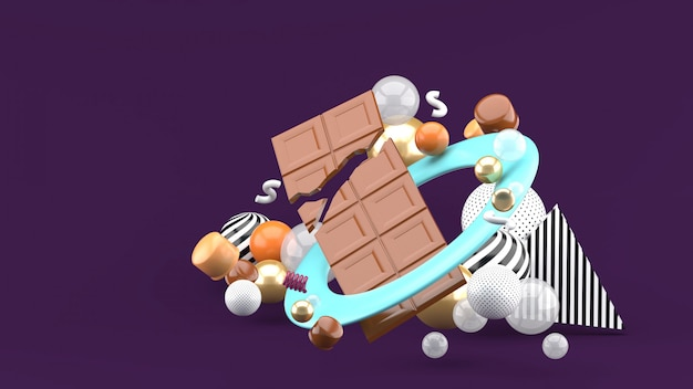 Chocolate bar tra le palline colorate nello spazio viola