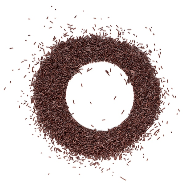Il cioccolato spruzza isolato vista dall'alto. decorazione con glassa marrone dolce o vermicelli al cioccolato