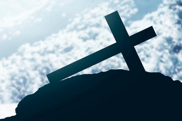 Croce cristiana sulla neve con sfondo nevicata