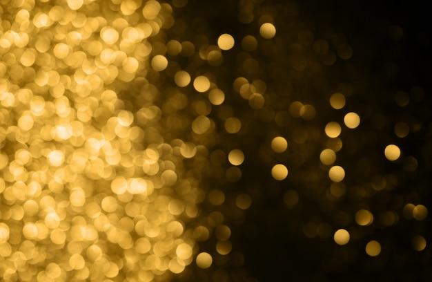 Sfondo di natale fondo astratto festivo con le luci e le stelle defocused del bokeh