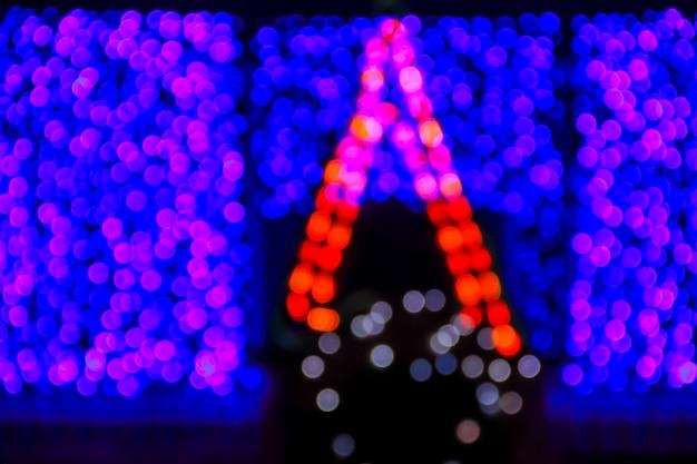 Sfondo di natale. fondo astratto di natale festivo con luci sfocate bokeh