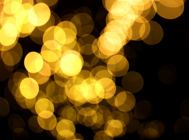 Sfondo di natale priorità bassa astratta festiva di natale con gli indicatori luminosi defocused del bokeh