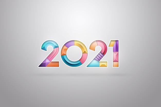 Sfondo di natale, iscrizione 2021 in numeri multicolori su sfondo chiaro.