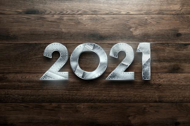 Sfondo di natale con scritte 2021 in numeri di metallo su uno sfondo di legno.
