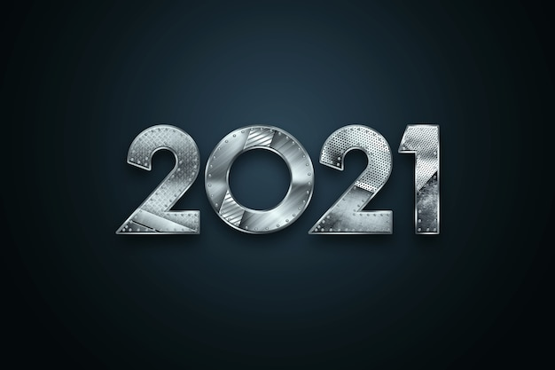 Sfondo di natale con scritte 2021 con numeri in metallo su sfondo scuro.