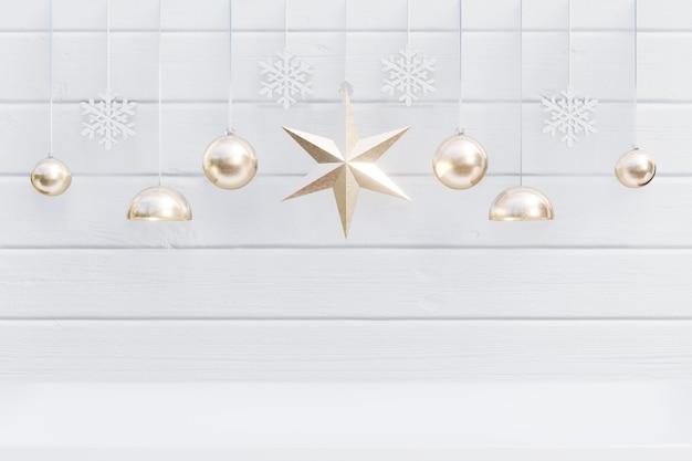 Fondo di natale con la stella dorata per i rami su fondo bianco di legno, rappresentazione 3d