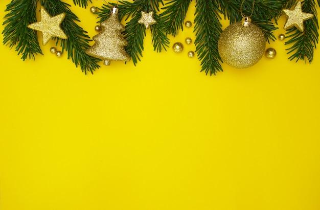 Sfondo di natale in giallo e oro