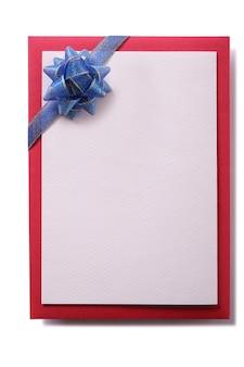 Cartolina di natale fiocco blu decorazione bianco verticale isolato
