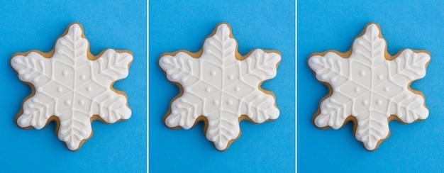 Collage di natale. pan di zenzero a forma di fiocco di neve sullo sfondo blu. avvicinamento.