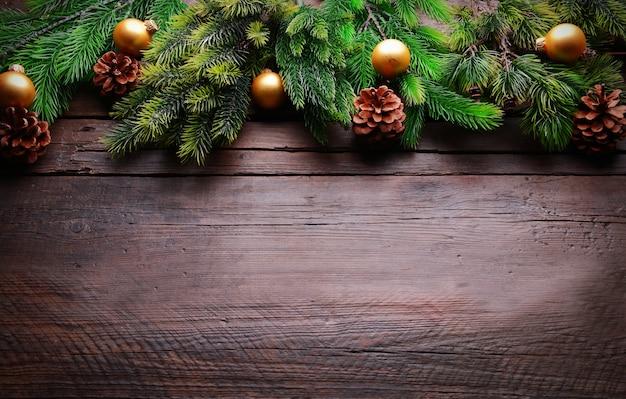 Blocco per grafici della decorazione di natale su fondo di legno