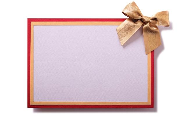 Auguri di natale carta fiocco oro decorazione vista frontale piatta