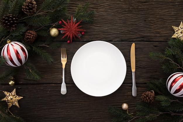 Il fondo della cena della tavola del partito del nuovo anno di natale celebra il tempo