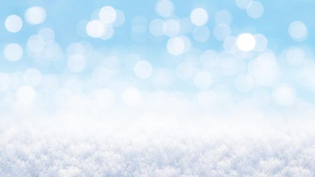 Sfondo invernale di natale e capodanno con neve e bokeh fuori fuoco