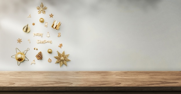 Decorazione di oggetti di natale a forma di albero di natale sulla parete con ombra di luce solare sulla parete sopra il tavolo
