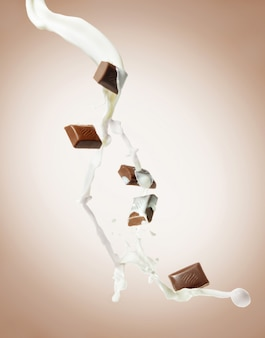 Pezzi di cioccolato con schizzi di latte