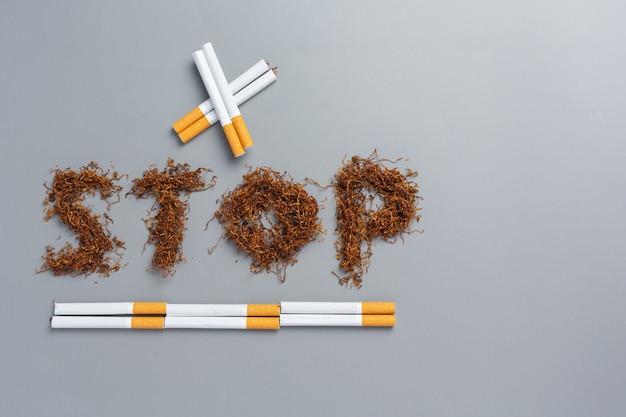 Sigaretta sulla superficie scura concetto di giornata mondiale senza tabacco.