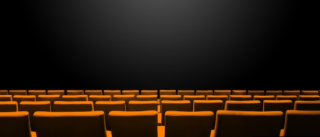 Cinema cinema con file di sedili arancioni e uno sfondo nero spazio copia. banner orizzontale