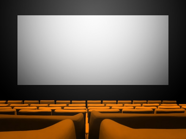 Cinema cinema con sedili in velluto arancione e uno schermo bianco vuoto
