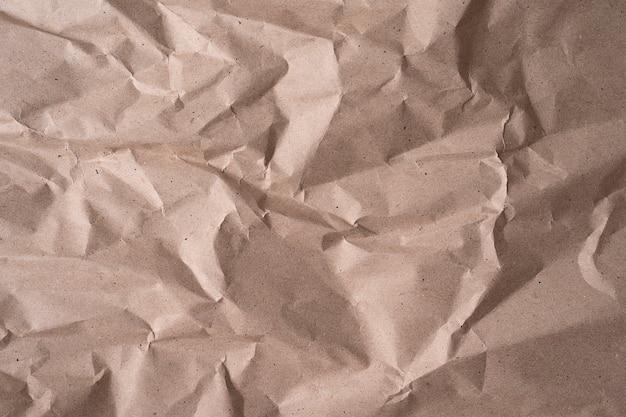 Pulire la carta riciclata beige, rugosa, sfondo astratto per il design. texture di carta stropicciata beige per sfondo o sfondo, immagine ravvicinata ad alta risoluzione