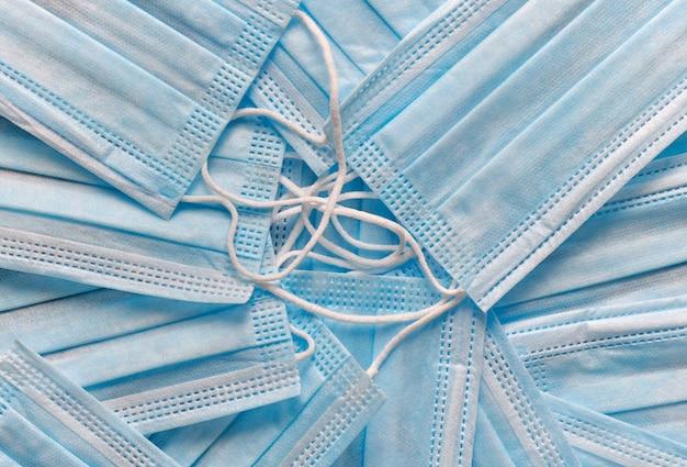 Sfondo di close-up di maschere mediche di colore blu
