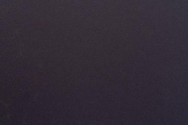 Close up di feltro nero trama del tessuto ruvido tessuto soffice di colore nero per gli sfondi