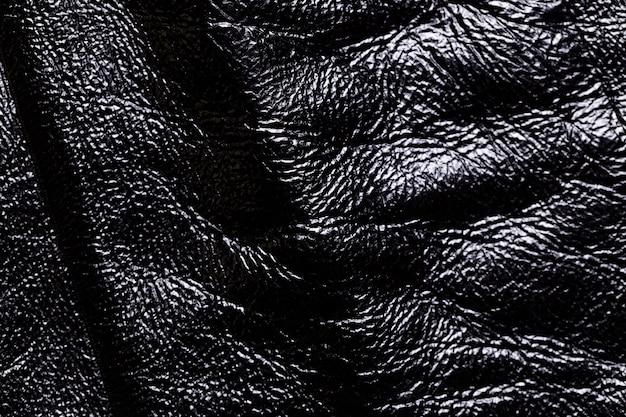 Primo piano di una priorità bassa di struttura di cuoio nero.