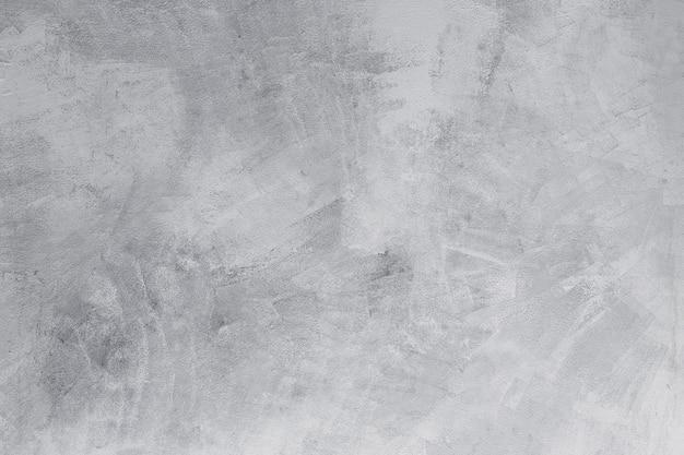 Primo piano del vecchio muro di cemento bianco