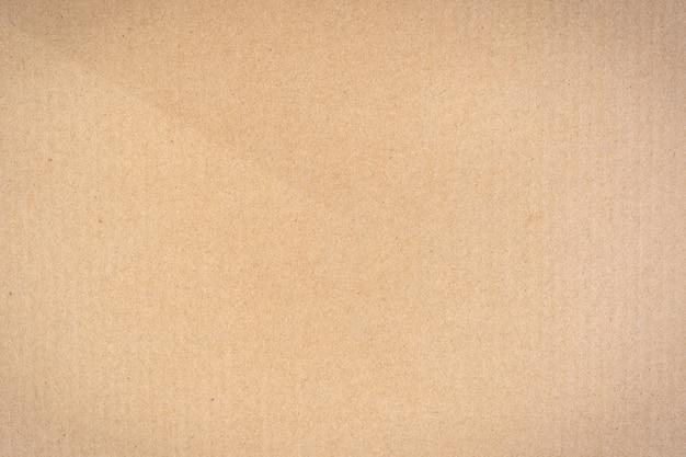 Chiudere la trama della scatola di carta marrone e lo sfondo