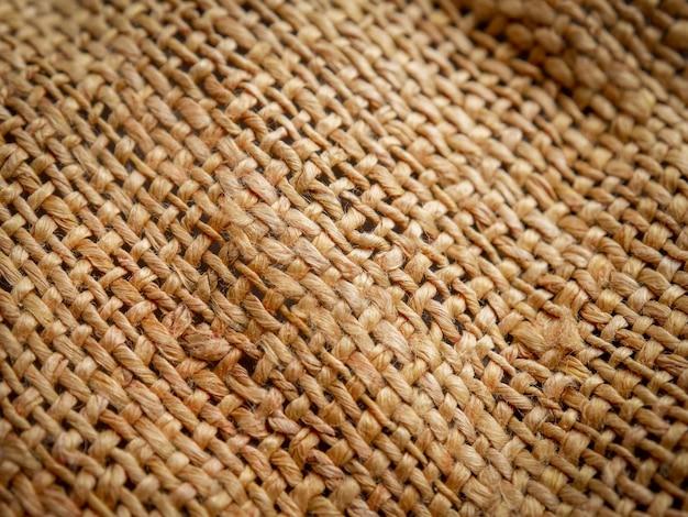Chiuda in su della priorità bassa marrone di struttura della tela di sacco. focalizzazione morbida
