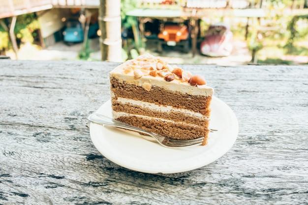 Close up torta di caffè sullo sfondo della tabella di legno